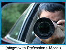 Man in a car taking a photo with a telephoto lens (Staged with Professional Model).