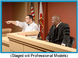 Male witness in a courtroom pointing something out to the judge (Staged with Professional Models).