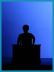 Black silhouette of man at a podium. (Staged with a professional model).