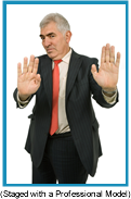 "Older man in suit with both hands extended palms up as if saying ""No Comment"". (Staged with Professional Model)."