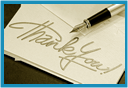 A thank you note with a pen resting on it.