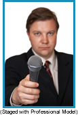 Man holding microphone in front of him as if asking for a answer. (Staged with profesisonal model).