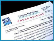 Close up of a mock press release from Justice Solutions.