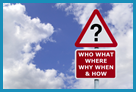 "Fictional red and white street sign with a triangle with a question mark and a rectangular sign saying ""Who, What, Where, Why, When & How""."
