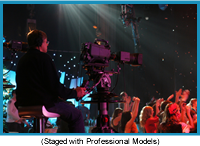 Cameraman above a crowded dancefloor in a dark atmosphere (staged with professional models).