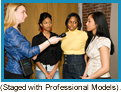Radio reporter interviewing two young African-American and one Asian girls. (Staged with professional models).